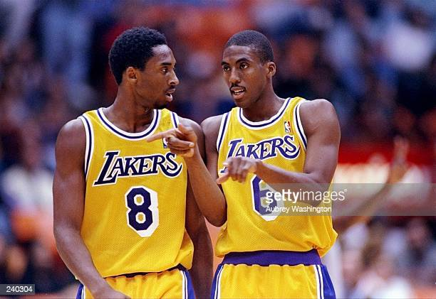 Guards Kobe Bryant and Eddie Jones of the Los Angeles Lakers talk during a game against the Utah Jazz at the Great Western Forum in Inglewood...