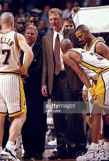Head coach Larry Bird of the Indiana Pacers talks to his team during a game against the Golden State Warriors at the Market Square Arena in...
