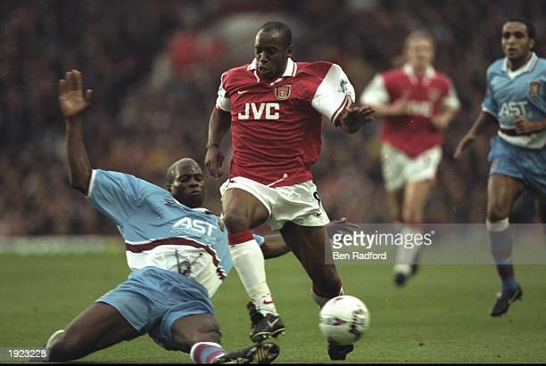 Ian Wright of Arsenal is tackled by Ugo Ehiogu of Aston Villa during the FA Carling Premiership match at Highbury in London The match was drawn 00...