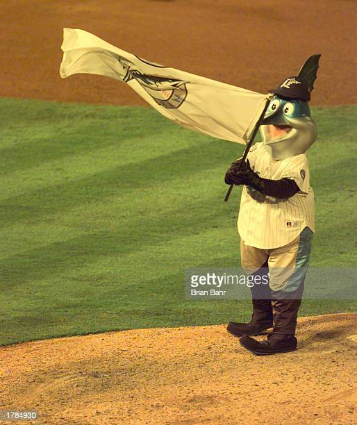 Mascot Billy the Marlin of the Florida Marlins waves a flag at the end of the game against the Cleveland Indians during Game 1 of the World Series at...