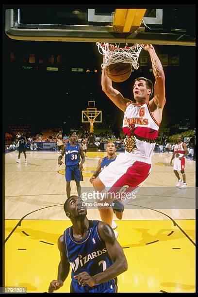 Matt Steigenga of the Atlanta Hawks dunks the basketball over God Shammgod of the Washington Wizards during the Hawks 10296 loss at the Great Western...
