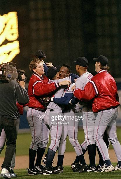 Outfielder Tony Fernandez of the Cleveland Indians is mobbed by his teammates during game six of the American League Championship against the...