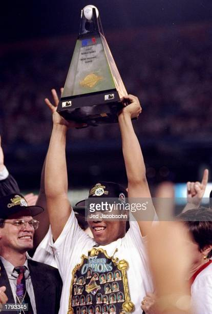 Pitcher Livan Hernandez of the Florida Marlins holds a trophy after the seventh game of the World Series against the Cleveland Indians at Pro Player...