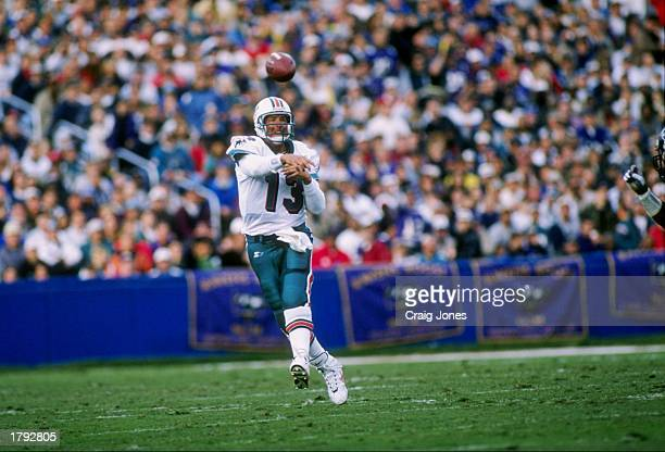 Quarterback Dan Marino of the Miami Dolphins throws a pass during the Dolphins 2413 win over the Baltimore Ravens at Memorial Stadium in Baltimore...