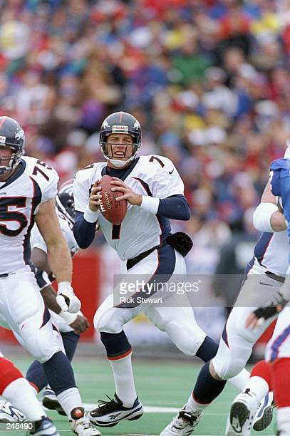 Quarterback John Elway of the Denver Broncos drops back to pass during a game against the Buffalo Bills at Rich Stadium in Orchard Park, New York....