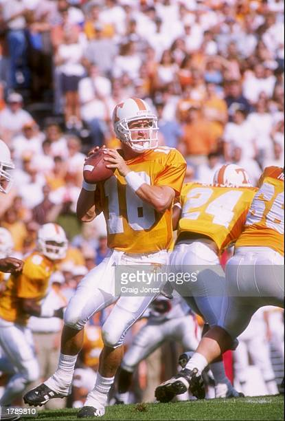 Quarterback Peyton Manning of the Tennessee Volunteers prepares to pass the ball during a game against the Georgia Bulldogs at Neyland Stadium in...