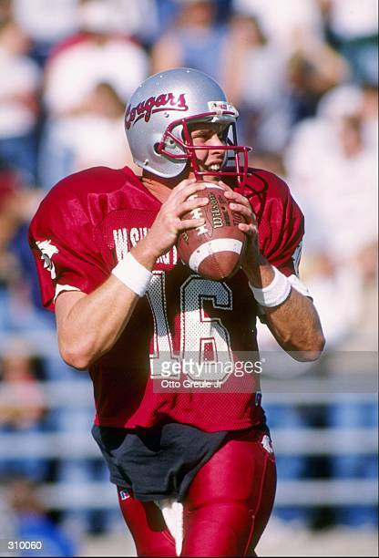 Quarterback Ryan Leaf of the Washington State Cougars looks to pass the ball during a game against the California Golden Bears at Martin Stadium in...