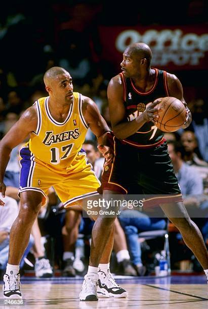 fcd0acb4f3d Rick Fox of the Los Angeles Lakers left guards Jerome Versey of the Seattle  SuperSonics in