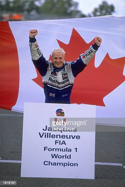 WilliamsRenault driver Jacques Villeneuve of Canada celebrates becoming the Formula One World Champion at the European Grand Prix in Jerez Spain...