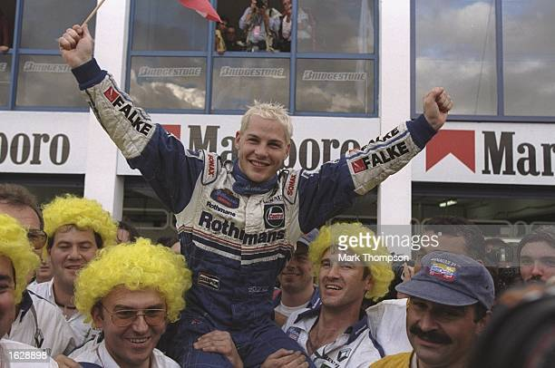 Williams-Renault driver, Jacques Villeneuve of Canada celebrates with the Williams team after the European Grand Prix in Jerez, Spain. Villeneuve...
