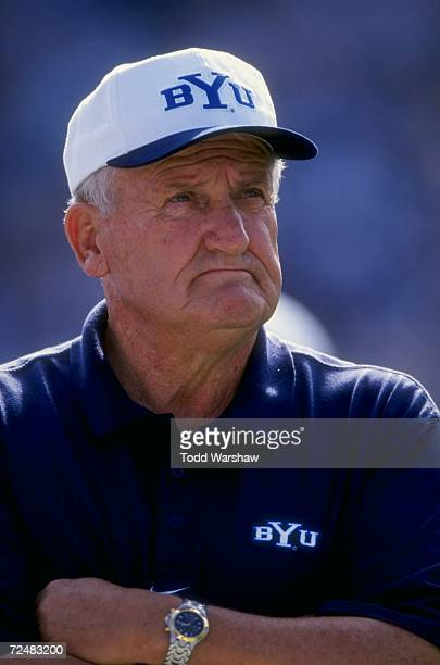 Portrait of head coach Lavell Edwards of the Bringham Young University Cougars as he watches the field during the game against the San Jose State...