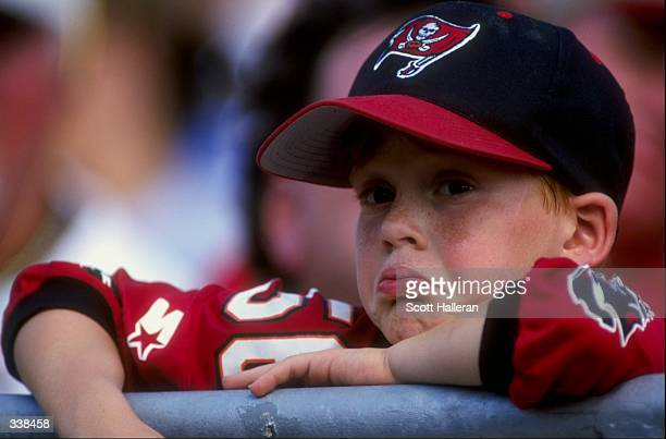 A Tampa Bay Buccaneers fan looks unhappy during a game against the Carolina Panthers at the Raymond James Stadium in Tampa Florida The Buccaneers...