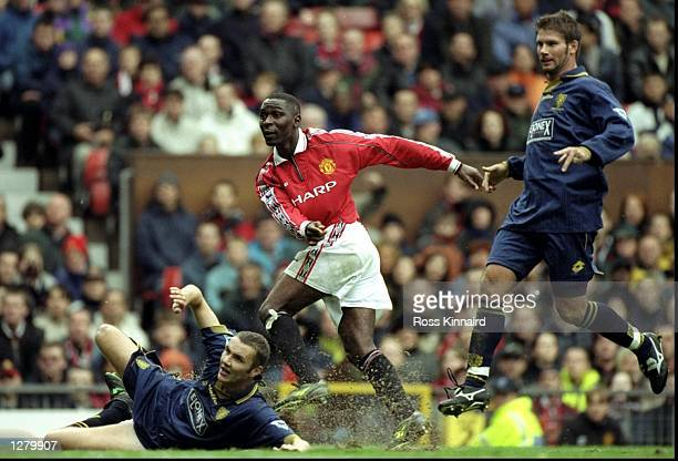 Andy Cole of Manchester United scores his second goal during the FA Carling Premiership match against Wimbledon at Old Trafford in Manchester England...