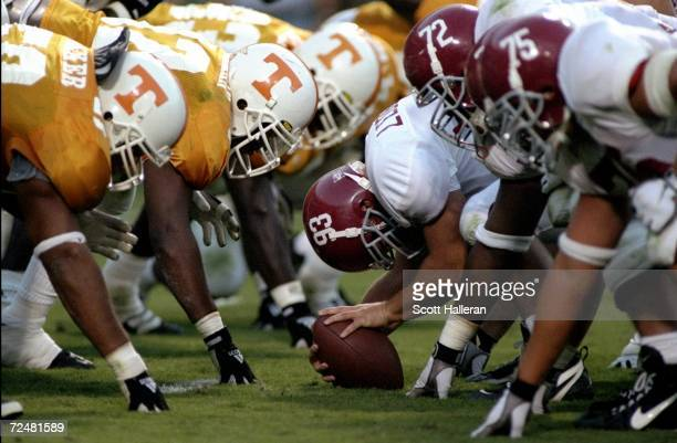 Bradley Ledbetter of the Alabama Crimson Tide prepares to snap the ball during a game against the Tennessee Volunteers at the Neyland Stadium in...