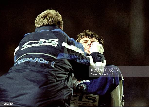 Chirs Sutton of Blackburn Rovers receives treatment during the FA Carling Premiership match against Arsenal at Ewood Park in Blackburn England...