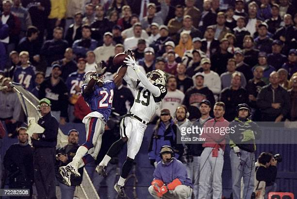 Cornerback Ty Law of the New England Patriots in action against wide receiver Keyshawn Johnson of the New York Jets during the game at the Foxboro...