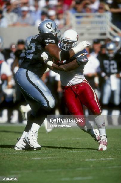 Defensive end Andre Wadsworth of the Arizona Cardinals blocks Jerome Daniels of the Oakland Raiders during a game at the Sun Devil Stadium in Tempe...
