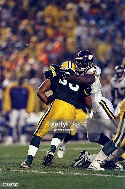 Defensive tackle John Randle of the Minnesota Vikings in action against fullback William Henderson of the Green Bay Packers during a game at the...