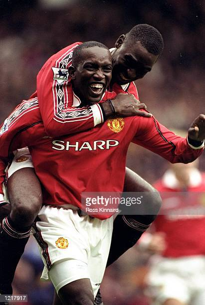 Dwight Yorke of Manchester United celebrates his goal with teammate Andy Cole during the FA Carling Premiership match against Wimbledon played at Old...
