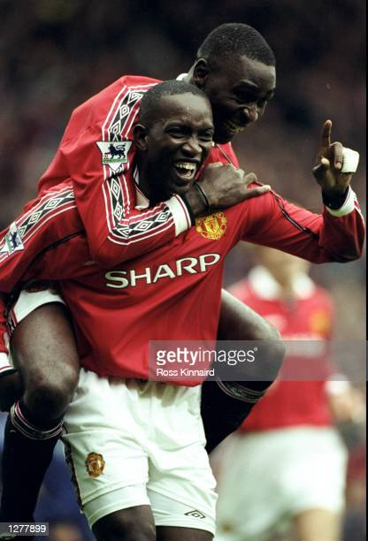 Dwight Yorke of Manchester United celebrates his goal with team mate Andy Cole during the FA Carling Premiership match against Wimbledon at Old...