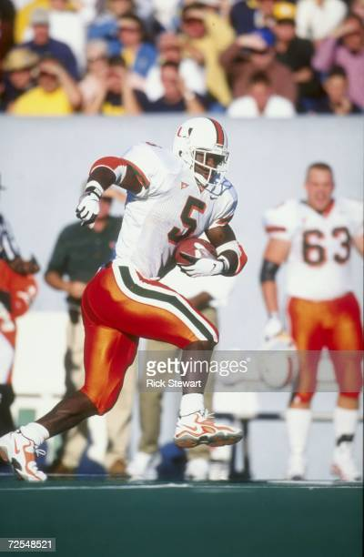 Edgerrin James of the Miami Hurricanes runs during the game against the West Virginia Mountaineers at Mountaineer Field in Morgan Filed West Virginia...