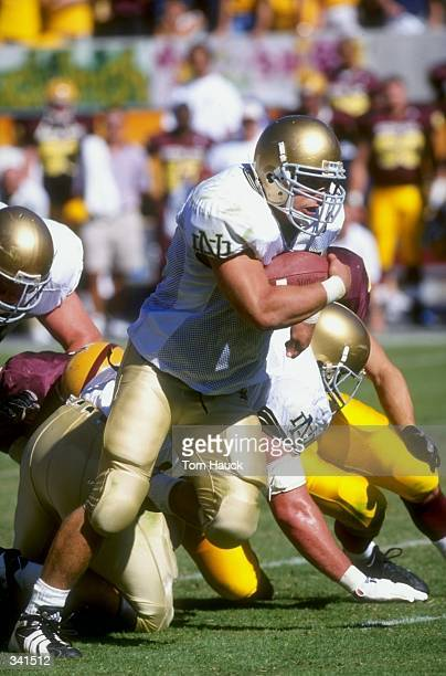 Fullback Joey Goodspeed of the Notre Dame Fighting Irish grips the ball as he runs during the game against the Arizona State Sun Devils at Sun Devil...