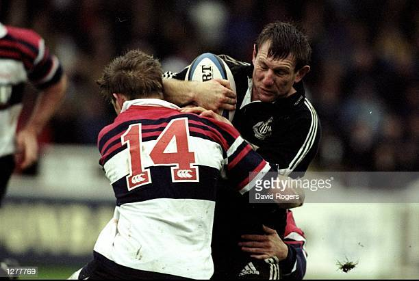 Gary Armstrong of Newcastle Falcons is tackled by Jonathon Benson of West Hartlepool during the Allied Dunbar Premiership match at Victoria Park in...