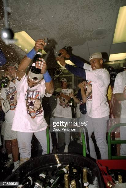 Infielder Quilvio Veras and outfielder Ruben Rivera of the San Diego Padres celebrate winning the pennant following the National League Championship...