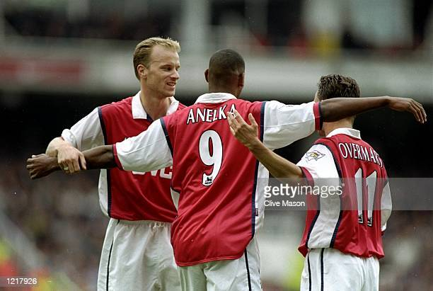 Nicolas Anelka of Arsenal is congratulated by his teammates Dennis Bergkamp and Marc Overmars after scoring a goal during the FA Carling Premiership...