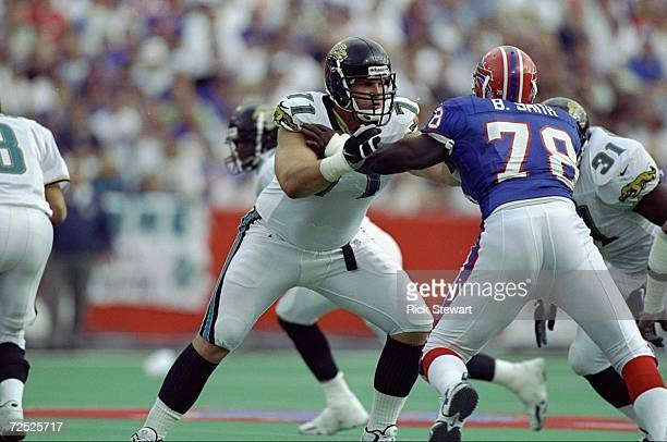 Offensive tackle Tony Boselli of the Jacksonville Jaguars in action against defensive end Bruce Smith of the Buffalo Bills during the game at the...