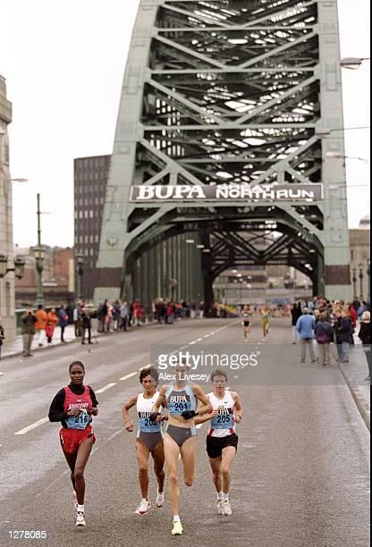 Pamela Chepchumba Manuela Machado eventual winner Sonia O'sullivan and Jo Thompson emerge from Tyne Bridge during the Great North Run in Newcastle...