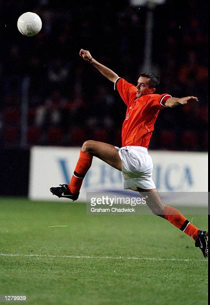 Phillip Cocu of Holland stretches during the friendly against Peru at the Phillips Stadium in Eindhoven Holland Mandatory Credit Graham Chadwick...