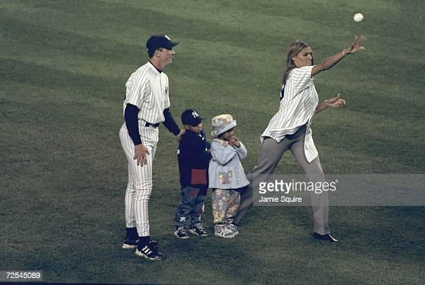 Pitcher David Cone of the New York Yankees stands with Charisse Strawberry and her children during the American League Championship Series Game 1...