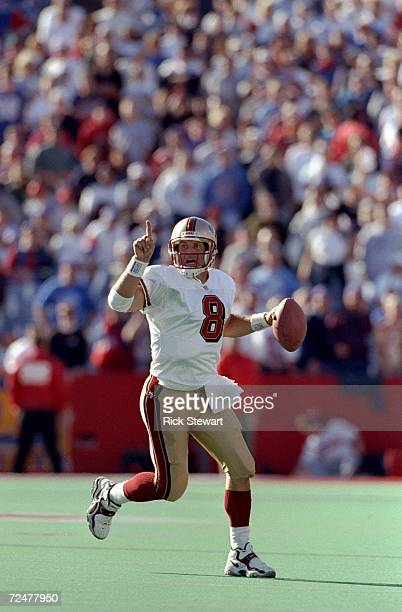 Quarterback Steve Young of the San Francisco 49ers in action during the game against the Buffalo Bills at the Bills Stadium in Orchard Park New York...