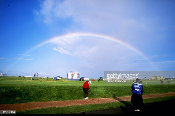 Rainbow over St Andrews as John Daly of the USA chips up during the Alfred Dunhill Cup in Scotland Mandatory Credit David Cannon /Allsport