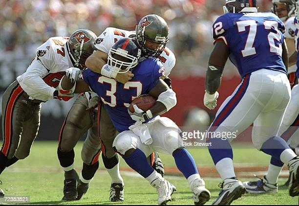 Safety John Lynch of the Tampa Bay Buccaneers in action against running back Gary Brown of the New York Giants during a game at the Raymond James...