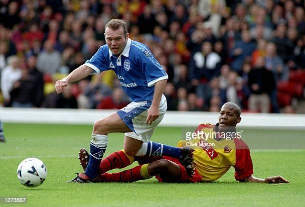 Simon Charlton of Birmingham City beats Micah Hyde of Watford Town during the Nationwide Division One game at Vicarage Road in Watford England...