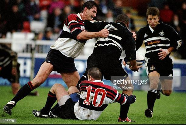 Va''aiga Tuigamala of Newcastle Falcons offloads to team mate Rob Andrew during the Allied Dunbar Premiership match against West Hartlepool at...