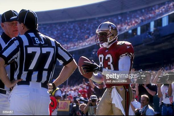 Wide receiver JJ Stokes of the San Francisco 49ers looks on as referee Terry McAulay discuss the play during a game against the Indianapolis Colts at...
