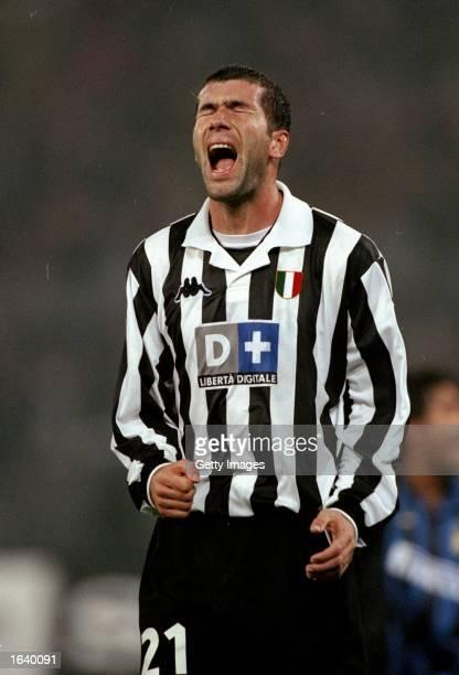 Zinedine Zidane of Juventus celebrates during the Italian Serie A match against Inter Milan at the Delle Alpi Stadium in Torino Italy Juventus won...