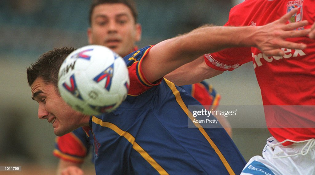 Ante Moric of Sydney United attempts to hold back #10 Clayton Zane of Northern Spirit during the match between Sydney United v Northern Spirit at Edensor park,Sydney Australia. Mandatory Credit: Adam Pretty/ALLSPORT