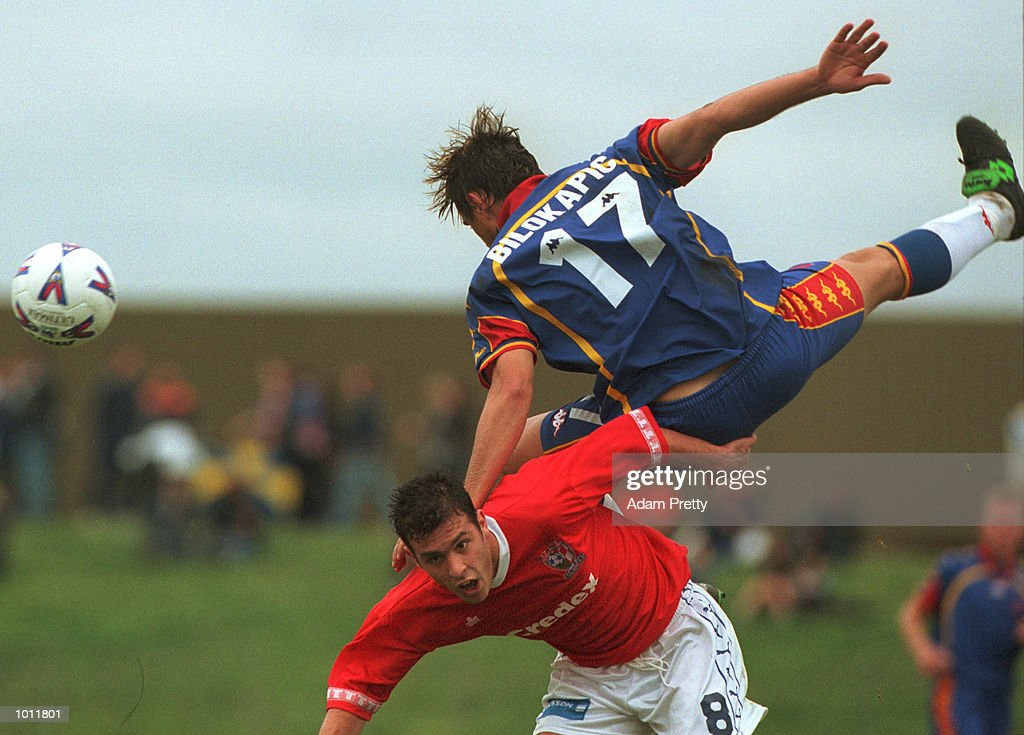 Paul Bilokapic of Northern Spirit spills over #8 Nahuel Arrarte of Sydney United during the match between Sydney United v Northern Spirit at Edensor park,Sydney Australia. Mandatory Credit: Adam Pretty/ALLSPORT