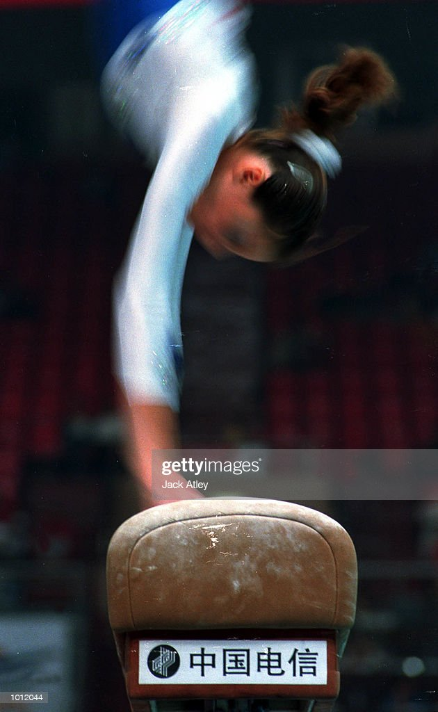 A competitor hits the vault during the womens qualifying round at the 1999 Tianjin World Gymnastics Championships, Tianjin, China. Mandatory Credit: Jack Atley/ALLSPORT