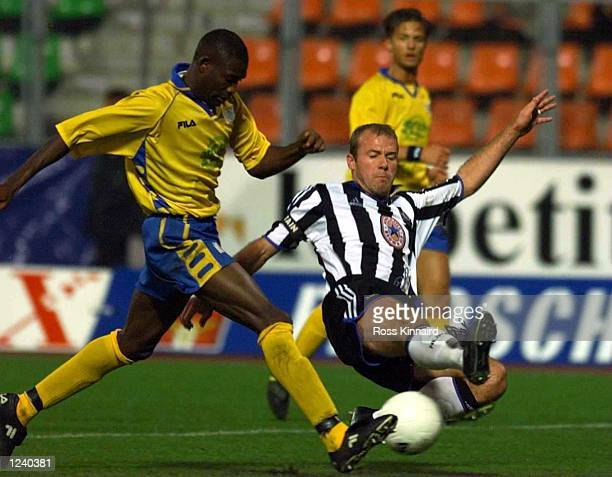 Alan Shearer of Newcastle is challenged by Saidou Kebe of Zurich during the FC Zurich v Newcastle United UEFA Cup tie, second round, firt leg at the...