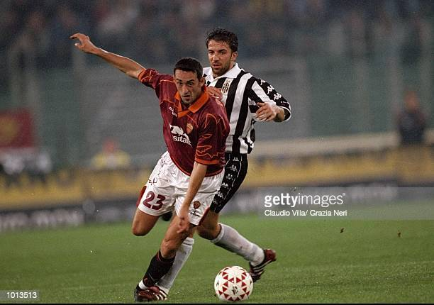 Alessandro Rinaldi of Roma goes away from Alessandro Del Piero of Juventus during the Seria A match at the Stadio Olimpico in Rome Italy Juventus won...