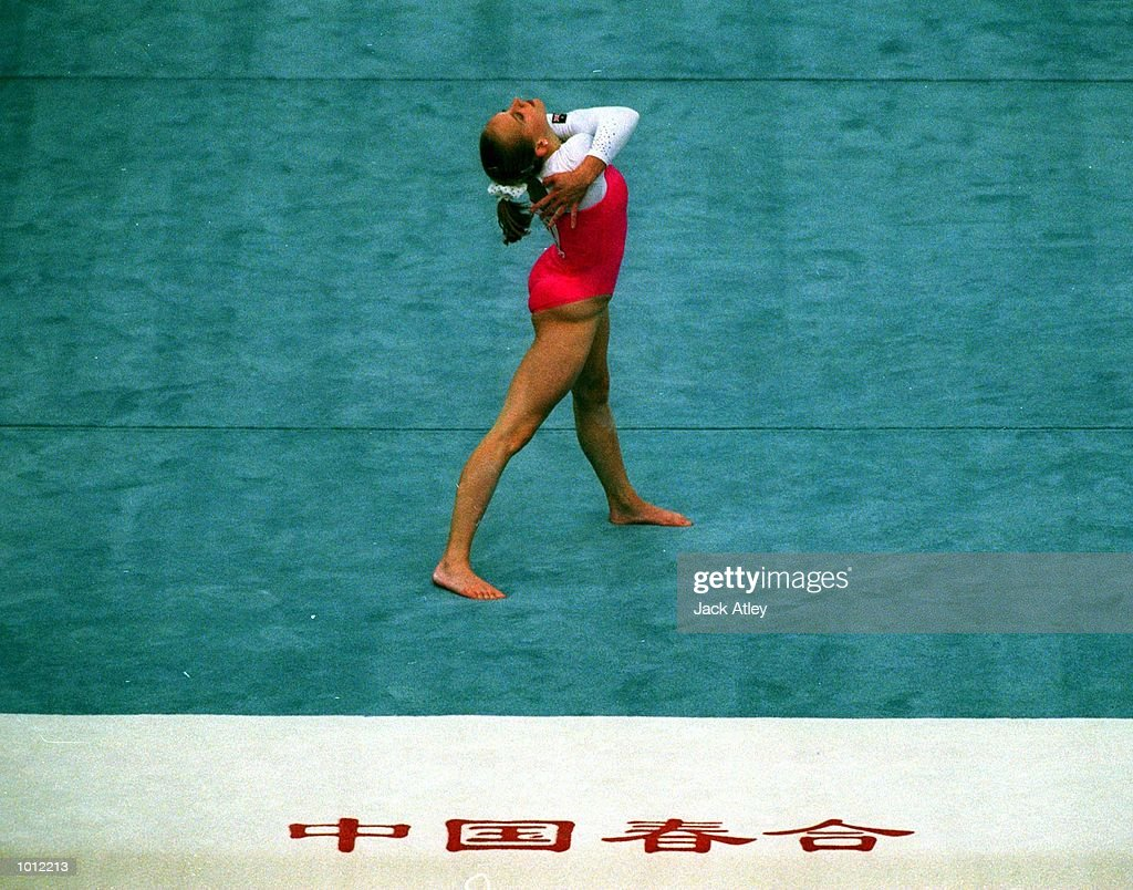 Allana Slater of Australia poses during her floor routine in the final of the womens teams event at the 1999 Tianjin World Gymnastics Championships, Tianjin, China. Australia finished fifth. Mandatory Credit: Jack Atley/ALLSPORT
