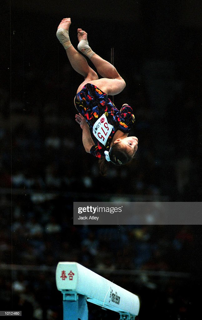 Andreea Raducan of Romania performs on the balance beam on her way to the silver medal for the beam during the individual apparatus womens finals competition at the 1999 Tianjin World Gymnastics Championships, Tianjin, China. Mandatory Credit: Jack Atley/ALLSPORT