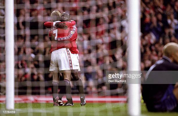 Andy Cole of Manchester United celebrates his goal with team mate David Beckham during the FA Carling Premiership match against Aston Villa at Old...