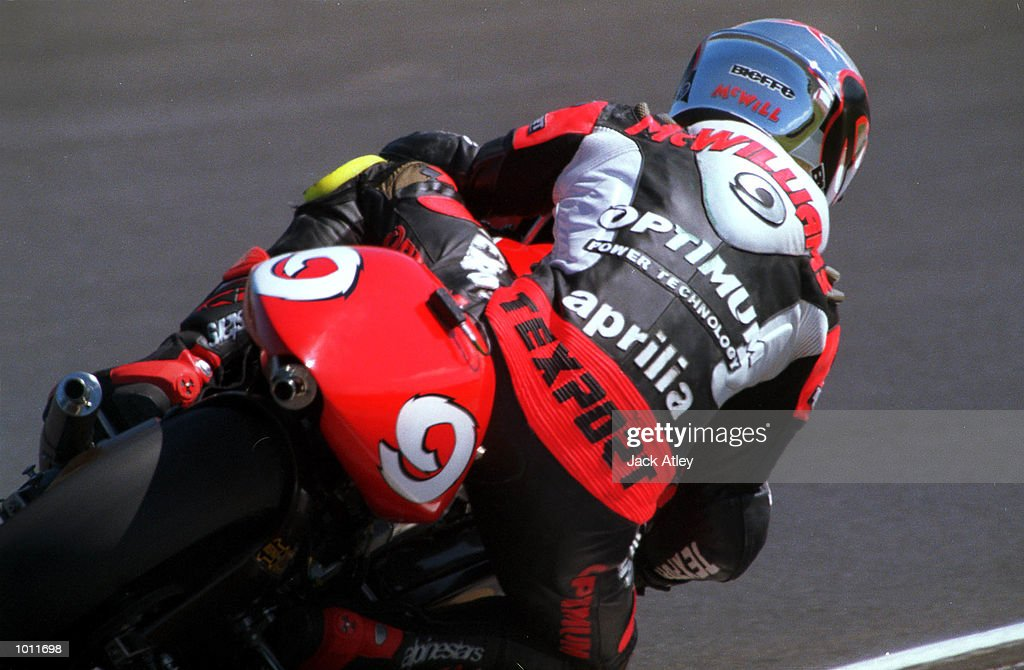 Aprilia team 250cc rider Jeremy McWilliams of Britain rounds Lukey Heights corner during qualifying today for the 1999 Australian Motorbike Grand Prix at Phillip Island, Victoria, Australia. McWilliams won pole position for the 250cc race. Mandatory Credit: Jack Atley/ALLSPORT