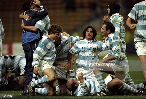 Argentinian players celebrate victory following the Rugby World Cup Quarter Final Play-Off between Ireland and Argentina from the Stade Felix...
